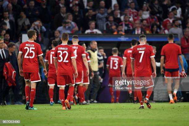 Bayern Munich players leave the pitch after the 12 defeat in the UEFA Champions League Semi Final First Leg match between Bayern Muenchen and Real...