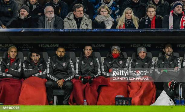 Bayern Munich players sit on the bench during the UEFA Champions League football match between Paris SaintGermain and Bayern Munich on December 5...