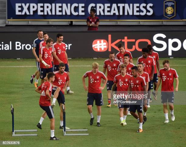 Bayern Munich players warm up during their official training session in Singapore on July 26 ahead of the International Champions Cup football match...