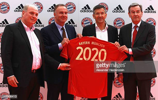 Bayern Munich President Uli Hoeness CEO KarlHeinz Rummenigge adidas CEO Herbert Hainer and CFO Karl Hopfner pose in the new FC Bayern Muenchen home...