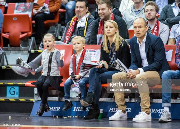 FC Bayern Munich soccer player Arjen Robben his wife Bernadien Eillert and two of their children sit in the stands at the German Bundesliga...