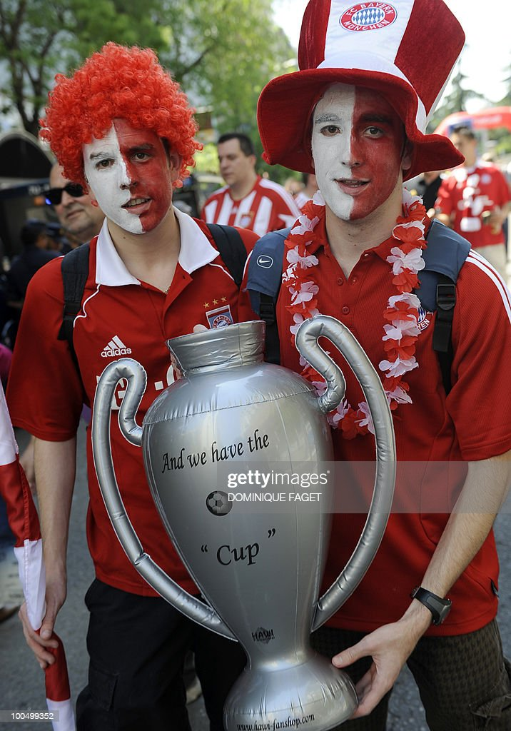 Bayern Munich supporters cary a mock trophy near the Santiago Bernabeu stadium in Madrid on May 22, 2010, hours before their team's UEFA Champions League final against Inter Milan.