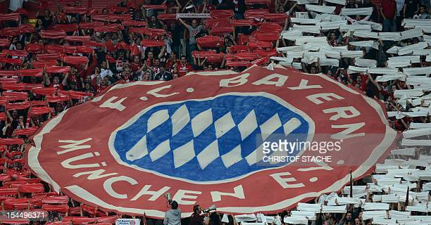 Bayern Munich supporters hold the club's logo ahead of the German first division Bundesliga football match Fortuna Duesseldorf vs FC Bayern Munich in...