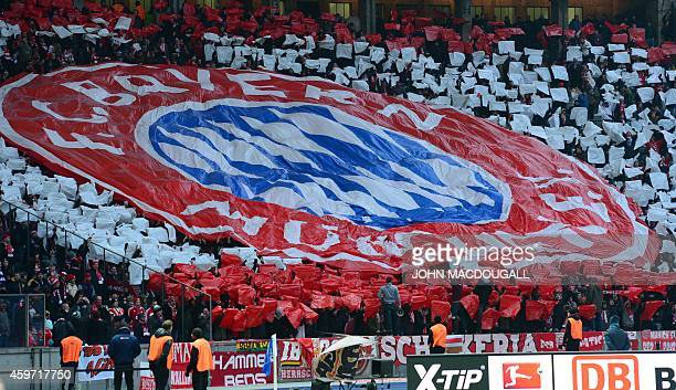 Bayern Munich supporters hold up a giant Bayern logo prior to the start of the German first division Bundesliga football match Hertha BSC Berlin vs...