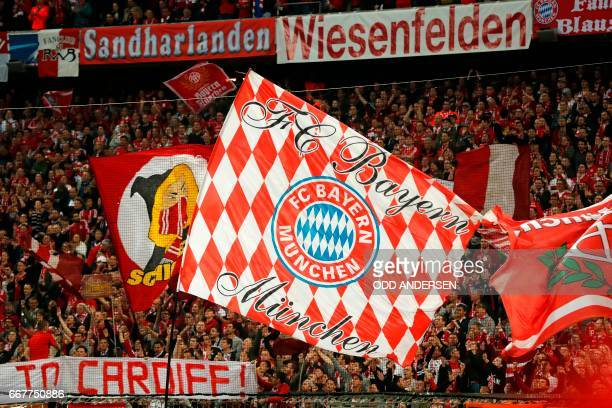 Bayern Munich supporters wave huge banners prior the UEFA Champions League 1st leg quarterfinal football match FC Bayern Munich v Real Madrid in...