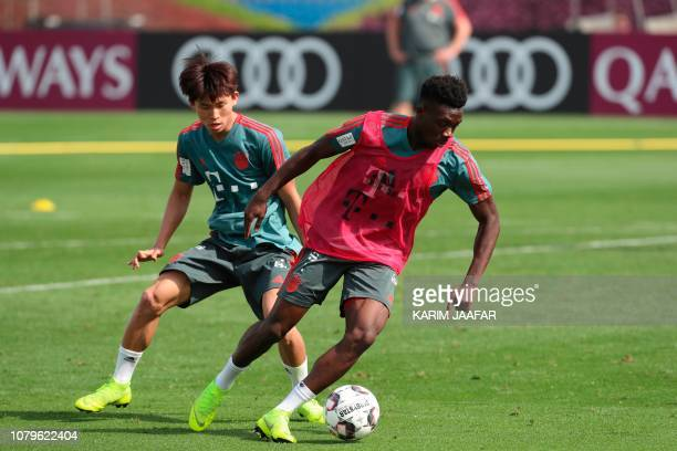 Bayern Munich's Alphonso Davies takes part in a training session during their winter training camp at the Aspire Academy for Sports Excellence in the...