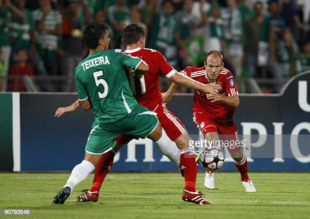 Bayern Munich's Arjen Robben competes against Maccabi Haifa defender Jorge Teixeira during their UEFA Champions League round match on September 15...