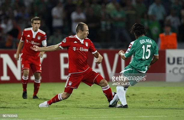Bayern Munich's Arjen Robben competes against Maccabi Haifa forward midfilder Eyal Golasa during their UEFA Champions League round match on September...