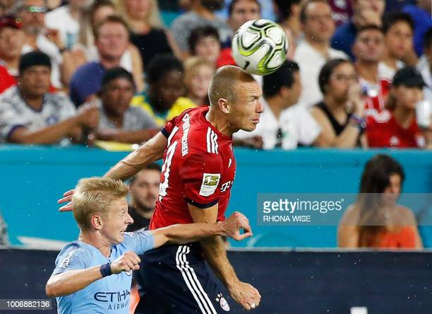 Bayern Munich's Arjen Robben heads the ball next to Manchester City's Oleksandr Zinchenko during the International Champions Cup friendly match...