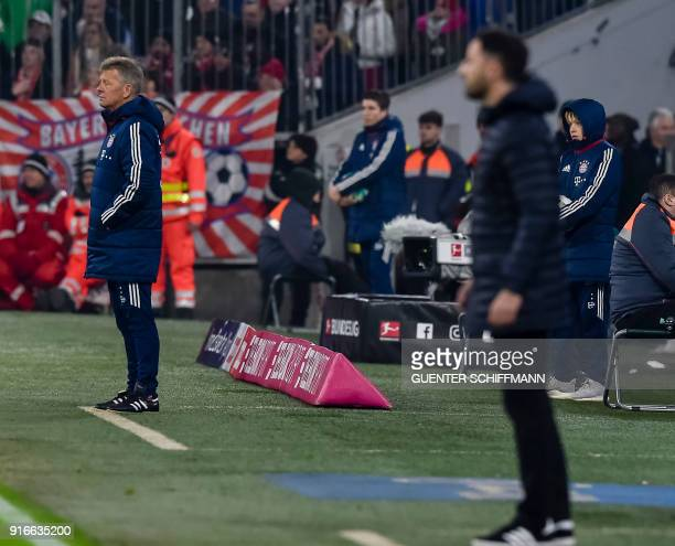 Bayern Munich's Assistant head coach Peter Hermann stands on the pitch during the German first division Bundesliga football match FC Bayern Munich vs...