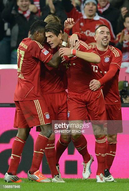 Bayern Munich's Austrain midfielder David Alaba Bayern Munich's Ukrain midfielder Anatoliy Tymoshchuk Bayern Munich's striker Mario Gomez and Bayern...