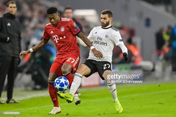 Bayern Munich's Austrian defender David Alaba and Benfica's Portuguese forward Rafa Silva vie for the ball during the UEFA Champions League Group E...