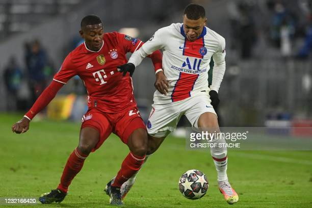 Bayern Munich's Austrian defender David Alaba and Paris Saint-Germain's French forward Kylian Mbappe vie for the ball during the UEFA Champions...
