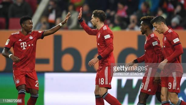 Bayern Munich's Austrian defender David Alaba Bayern Munich's midfielder Leon Goretzka Bayern Munich's French defender Kingsley Coman and Bayern...
