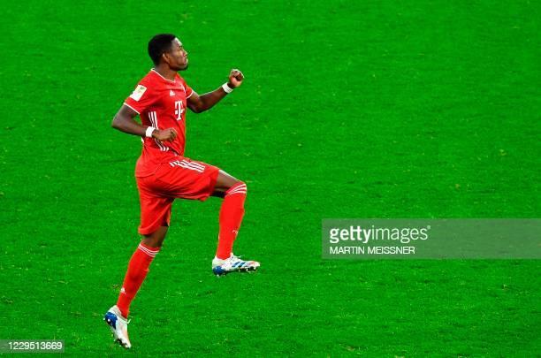 Bayern Munich's Austrian defender David Alaba celebrates after scoring during the German first division Bundesliga football match between BVB...
