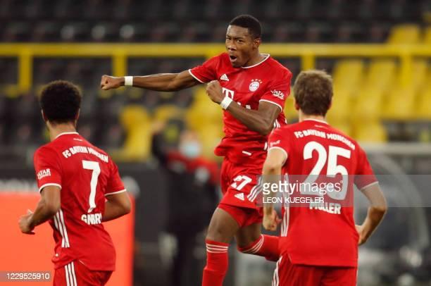 Bayern Munich's Austrian defender David Alaba celebrates after scoring Bayern's first goal during the German first division Bundesliga football match...