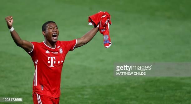 Bayern Munich's Austrian defender David Alaba celebrates after winning at the end of the UEFA Champions League final football match between Paris...