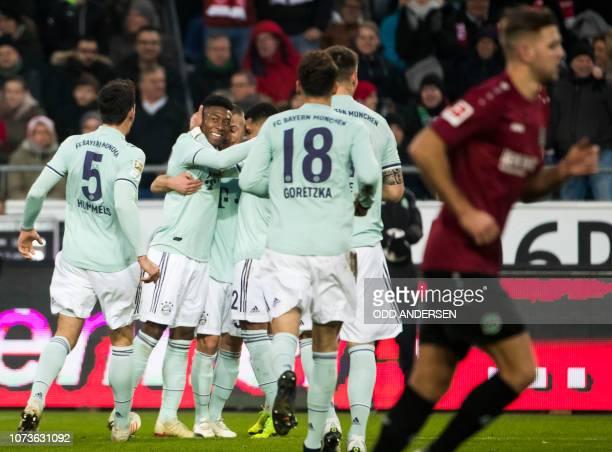 Bayern Munich's Austrian defender David Alaba celebrates scoring during the German first division Bundesliga football match Hannover 96 v Bayern...