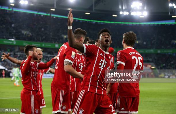 Bayern Munich's Austrian defender David Alaba celebrates with teammates after they scored during the German first division Bundesliga football match...