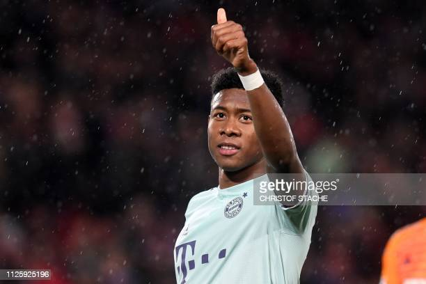 Bayern Munich's Austrian defender David Alaba gestures to supporters on the pitch after the UEFA Champions League round of 16 first leg football...