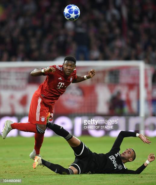 Bayern Munich's Austrian defender David Alaba heads the ball during the UEFA Champions League Group E football match between Bayern Munich and Ajax...