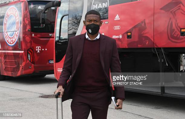 Bayern Munich's Austrian defender David Alaba leaves the airport upon arrival in Munich, southern Germany, on April 14, 2021 as the FC Bayern Munich...