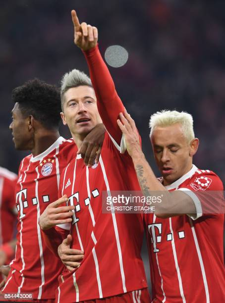Bayern Munich's Austrian defender David Alaba Polish striker Robert Lewandowski and Brazilian defender Rafinha celebrate after their third goal...