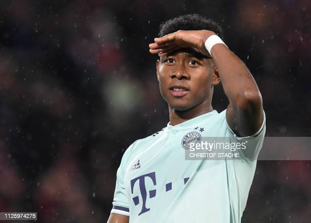 Bayern Munich's Austrian defender David Alaba reacts after the UEFA Champions League round of 16 first leg football match between Liverpool and...