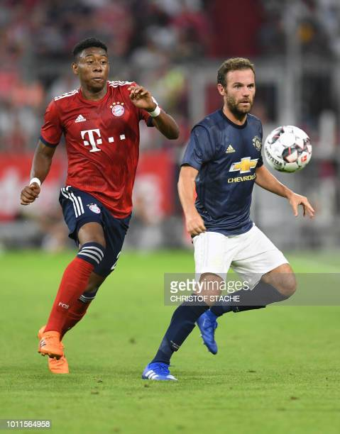 Bayern Munich's Austrian defender David Alaba vies with Manchester's Spanish midfielder Juan Mata uring a friendly football match between FC Bayern...