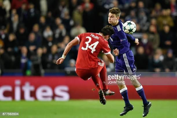 Bayern Munich's Austrian defender Marco Friedl vies with Anderlecht's Belgian midfielder Pieter Gerkens during the UEFA Champions League Group B...