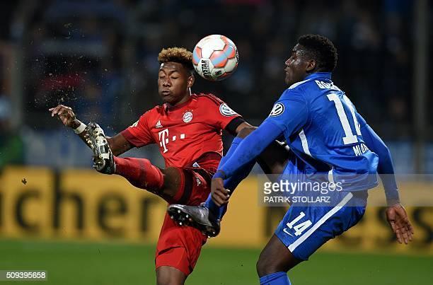 TOPSHOT Bayern Munich's Austrian midfielder David Alaba and Bochum's Peniel Mlapa vie for the ball during the German Cup quarter final football match...