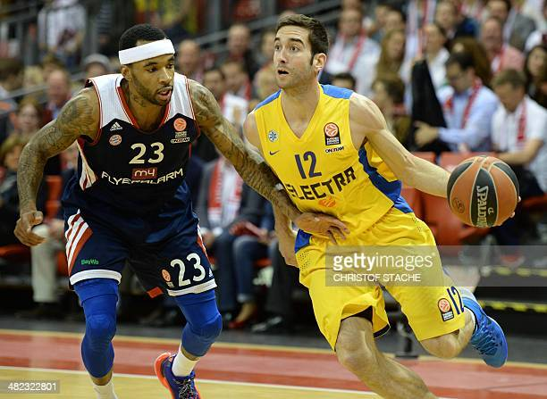 Bayern Munich's basketball player Malcolm Delaney and Maccabi Tel Aviv's Basketball player Yogev Ohayon vie for the ball during the Euroleague top...