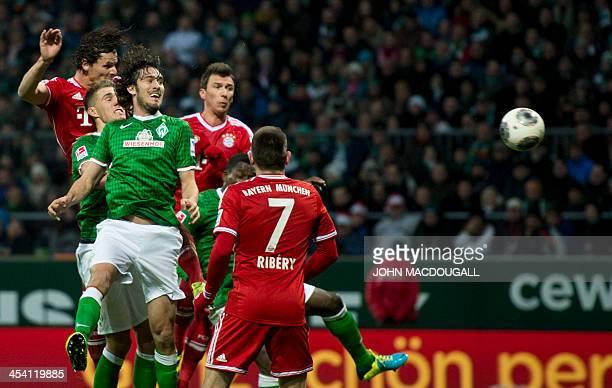 Bayern Munich's Belgian defender Daniel van Buyten scores the second goal during the German first division Bundesliga football match between SV...