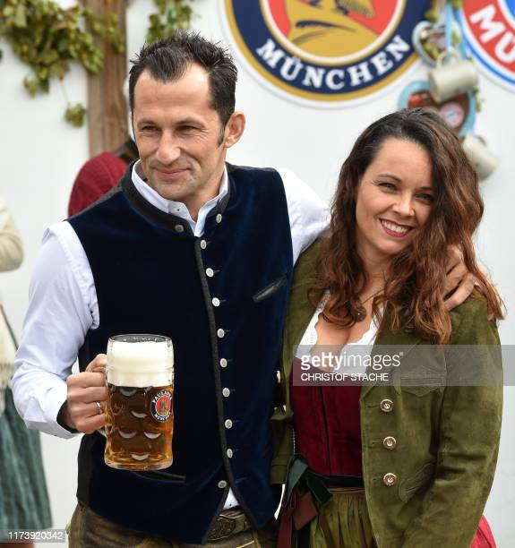 Bayern Munich's Bosnian Sporting director Hasan Salihamidzic and his wife Esther Copado arrive for the football club's annual visit at the...