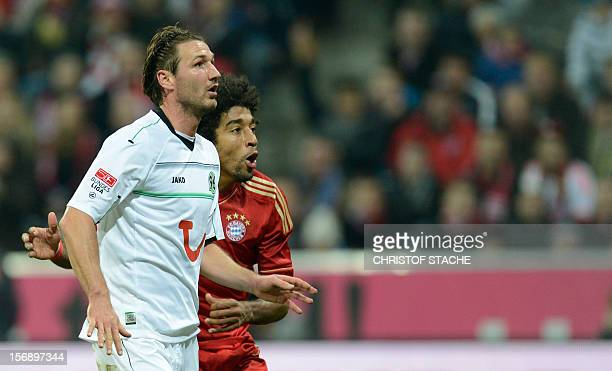 Bayern Munich's Brazil defender Dante and Hanover's defender Christian Schulz watch the ball during the German first division Bundesliga football...