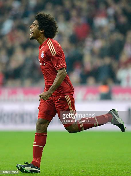 Bayern Munich's Brazil defender Dante celebrates after the fourth goal for Munich during the German first division Bundesliga football match FC...
