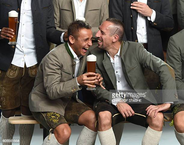 TOPSHOT Bayern Munich's Brazilian defender Rafinha and Bayern Munich's French midfielder Franck Ribery share a smile as they pose in typicial...