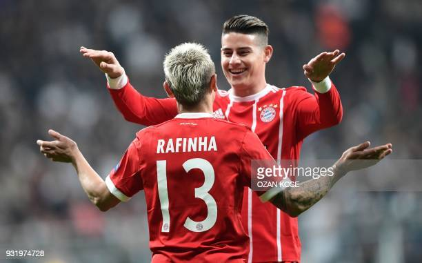 Bayern Munich's Brazilian defender Rafinha celebrates with teammate Colombian midfielder James Rodriguez after Besiktas scored an own goal during the...