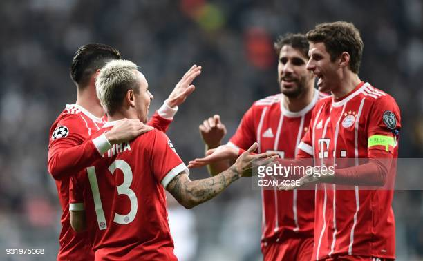 Bayern Munich's Brazilian defender Rafinha celebrates with teammates Bayern Munich's German forward Thomas Mueller after Besiktas scored an own goal...