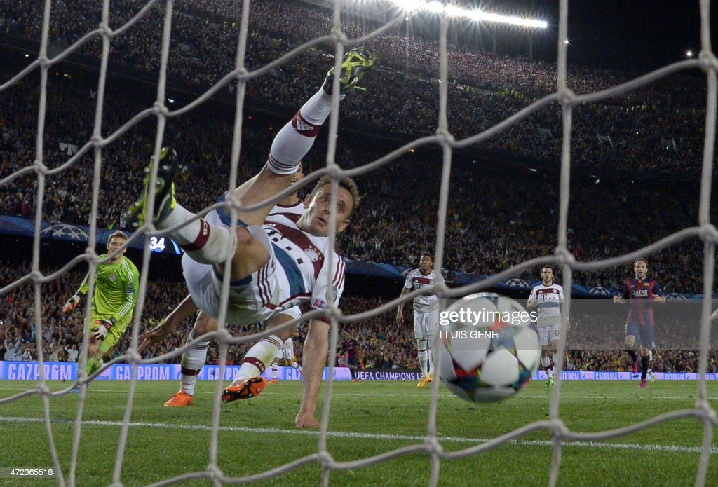 Bayern Munich's Brazilian defender Rafinha fails to save a goal of Messi during the UEFA Champions League football match FC Barcelona vs FC Bayern Muenchen at the Camp Nou stadium in Barcelona on May 6, 2015. Barcelona won 3-0.
