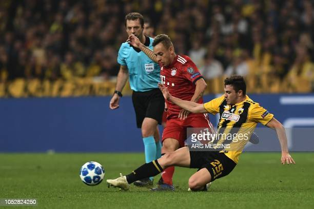Bayern Munich's Brazilian defender Rafinha vies with AEK's Greek midfielder Kostas Galanopoulos during the UEFA Champions League football match...