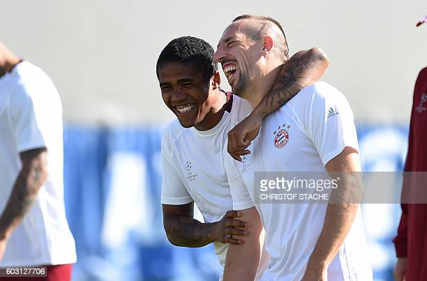 Bayern Munich's Brazilian midfielder Douglas Costa and Bayern Munich's French midfielder Franck Ribery attend the final team training session on the...