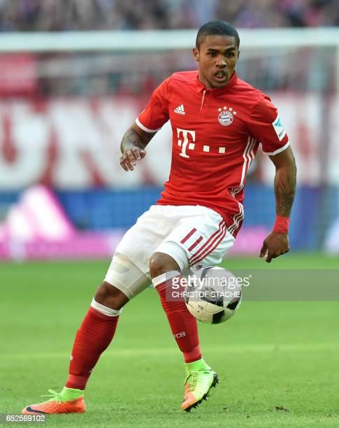 Bayern Munich's Brazilian midfielder Douglas Costa plays the ball during the German First division Bundesliga football match Bayern Munich vs...