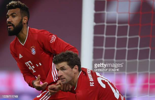 Bayern Munich's Cameroonian forward Eric Maxim ChoupoMoting and Bayern Munich's German forward Thomas Mueller react during the German first division...