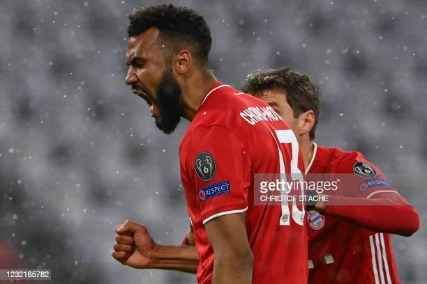 Bayern Munich's Cameroonian forward Eric Maxim Choupo-Moting celebrates scoring the 1-2 goal with his team-mate Bayern Munich's German forward Thomas...