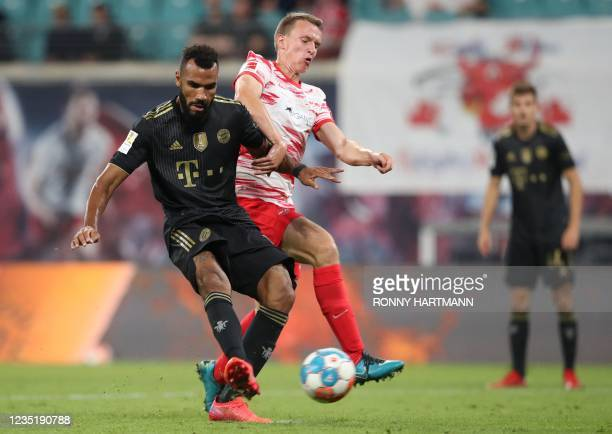 Bayern Munich's Cameroonian forward Eric Maxim Choupo-Moting scores the 1-4 past Leipzig's German defender Lukas Klostermann during the German first...