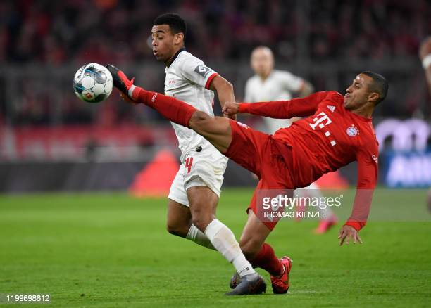 Bayern Munich's Canadian midfielder Alphonso Davies and Leipzig's US midfielder Tyler Adams vie for the ball during the German first division...