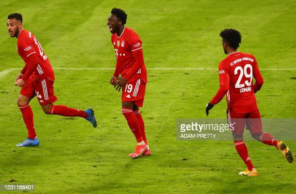 Bayern Munich's Canadian midfielder Alphonso Davies celebrates scoring the 3-3 goal with his team-mates during the German first division Bundesliga...