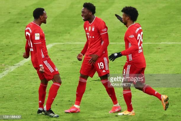 Bayern Munich's Canadian midfielder Alphonso Davies celebrates scoring the 3-3 goal with his team-mates Bayern Munich's Austrian defender David Alaba...