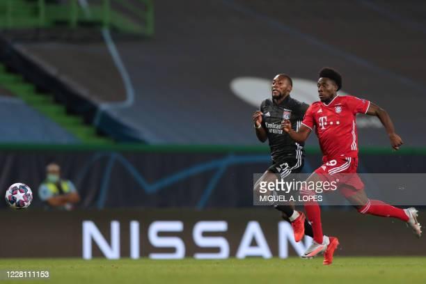 Bayern Munich's Canadian midfielder Alphonso Davies challenges Lyon's Cameroonian forward Karl Toko Ekambi during the UEFA Champions League semifinal...